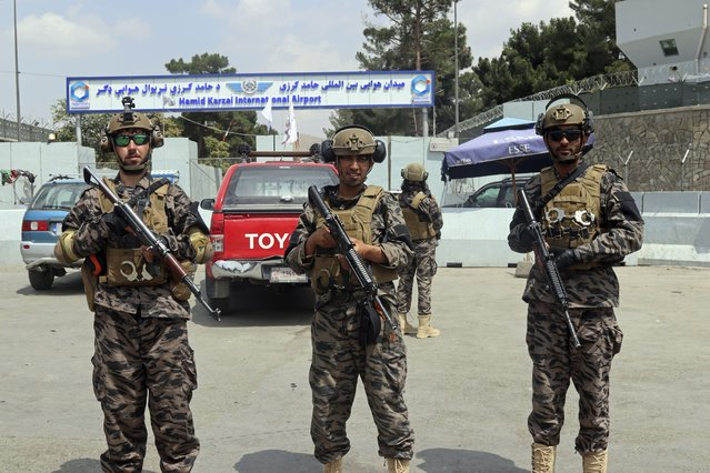 Taliban special forces fighters stand guard outside the Hamid Karzai International Airport after the U.S. military's withdrawal, in Kabul, Afghanistan, Tuesday, August 31, 2021. The Taliban were in full control of Kabul's airport on Tuesday, after the last U.S. plane left its runway, marking the end of America's longest war. (Photo by Khwaja Tawfiq Sediqi/AP Photo)