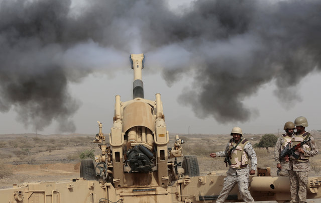 Saudi soldiers fire artillery toward three armed vehicles approaching the Saudi border with Yemen in Jazan, Saudi Arabia, Monday, April 20, 2015. The Saudi air campaign in Yemen is now in its fourth week. (Photo by Hasan Jamali/AP Photo)