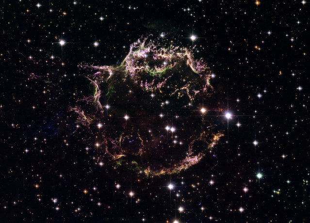 This image made by the NASA/ESA Hubble Space Telescope shows the tattered remains of a supernova explosion known as Cassiopeia A. It is the youngest known remnant from a supernova explosion in the Milky Way. (Photo by NASA, ESA, Hubble Heritage STScI/AURA-ESA/Hubble Collaboration via AP Photo)