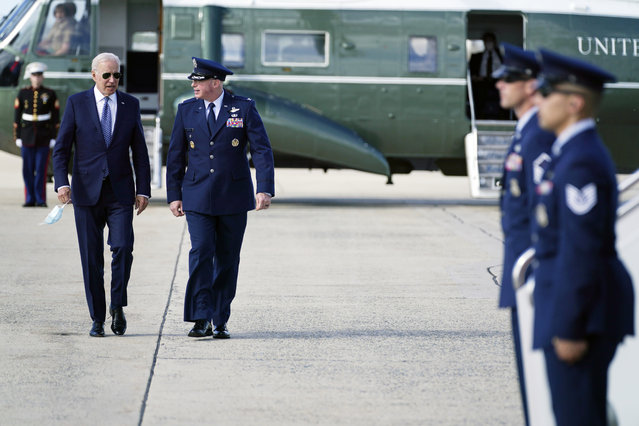 President Joe Biden speaks with Colonel William (Chris) McDonald, Vice Commander, 89th Air Wing before boarding Air Force One for a trip to New York to attend the United Nations General Assembly, Monday, Sept. 20, 2021, at Andrews Air Force Base, Md. (Photo by Evan Vucci/AP Photo)