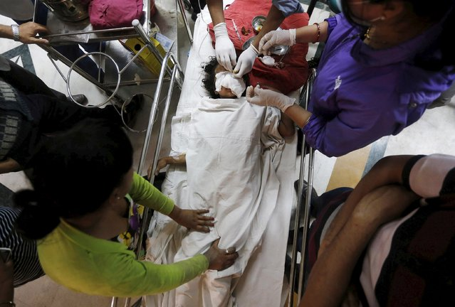 Doctors attend to a girl who sustained injuries in Saturday's earthquake, at a hospital in Kathmandu, Nepal April 28, 2015. (Photo by Adnan Abidi/Reuters)