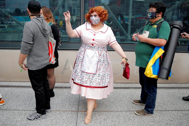 A woman in custume and a protective face mask waits with others in line to attend the 2021 New York Comic Con, at the Jacob Javits Convention Center in Manhattan in New York City, New York, U.S., October 7, 2021. (Photo by Brendan McDermid/Reuters)