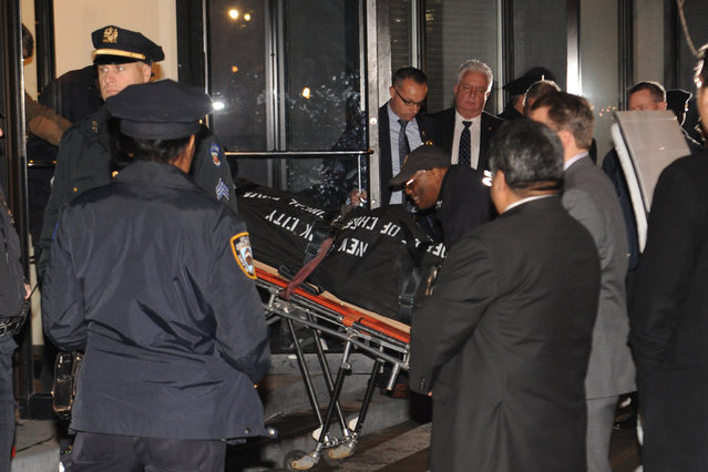 A body is taken from the apartment building that Philip Seymour Hoffman lived in, Sunday, February 2, 2014, in New York. He was 46. (Photo by Louis Lanzano/AP Photo)