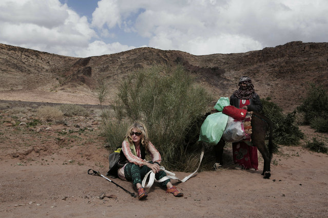 In this March 30, 2019 photo, Julie Patterson, a Sinai Trail trip officer rests with guide Umm Yasser, on a trek in the mountains, near Wadi Sahw, Abu Zenima, in South Sinai, Egypt. (Photo by Nariman El-Mofty/AP Photo)