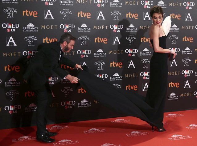 Nieves Alvarez is helped to arrange her dress as she poses on the red carpet before the Spanish Film Academy's Goya Awards ceremony in Madrid, Spain, February 4, 2017. (Photo by Juan Medina/Reuters)