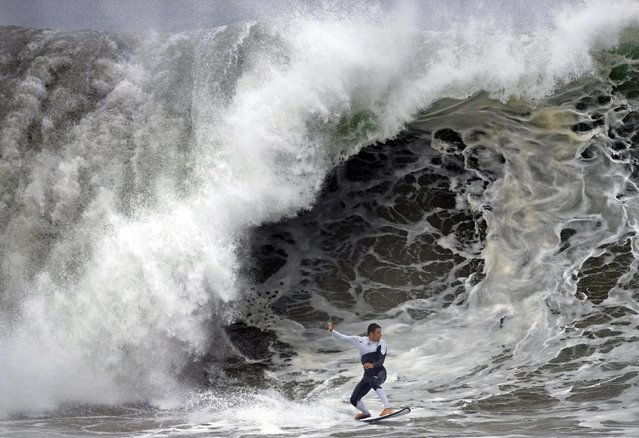 A person surfs at the Wedge in Newport Beach, Calif., Monday, May 4, 2015. (Photo by Mindy Schauer/AP Photo/The Orange County Register)