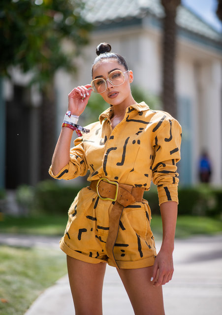 Olivia Culpo is seen wearing yellow jacket and shorts with print and brown belt at the Revolve Festival during Coachella Festival on April 14, 2019 in La Quinta, California. (Photo by Christian Vierig/GC Images)
