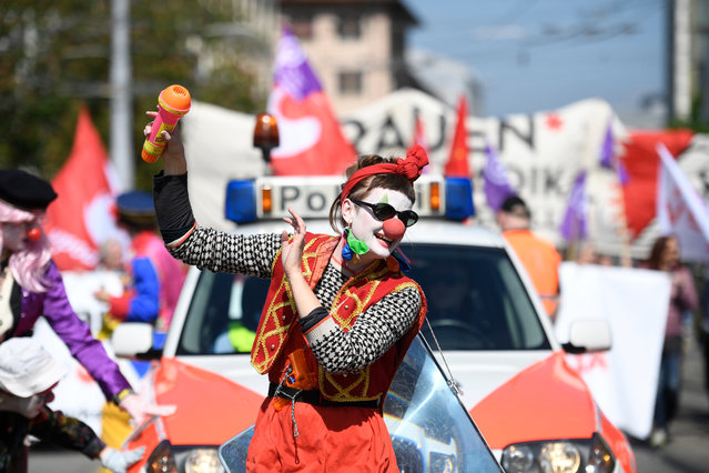 A protester, dressed as a clown, marches on a road to mark Labor Day in Zurich, Switzerland, 01 May 2019. (Photo by Ennio Leanza/EPA/EFE)