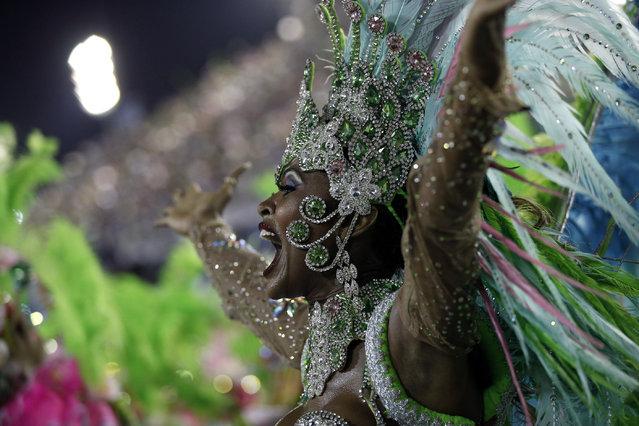 Performer from the Mangueira samba school parades during carnival celebrations at the Sambadrome in Rio de Janeiro, Brazil, Monday, March 3, 2014. (Photo by Silvia Izquierdo/AP Photo)