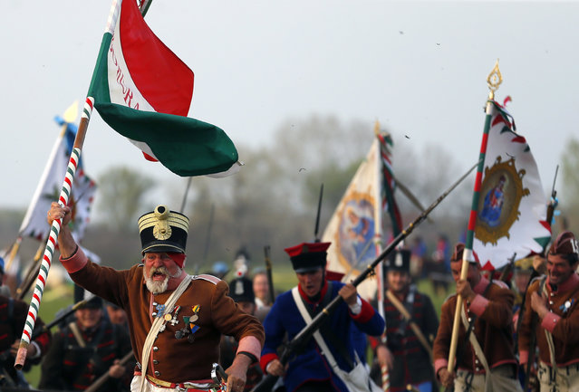 People dressed as Hungarian Hussars and Austrian soldiers of the Habsburg dynasty take part in the re-enactment of the battle in Tapiobicske, Hungary  April 4, 2016. (Photo by Laszlo Balogh/Reuters)