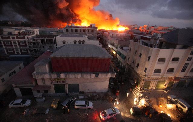 A general view shows burning stalls at the main Bakara market in Somalia's capital Mogadishu, February 27, 2017. (Photo by Ismail Taxta/Reuters)