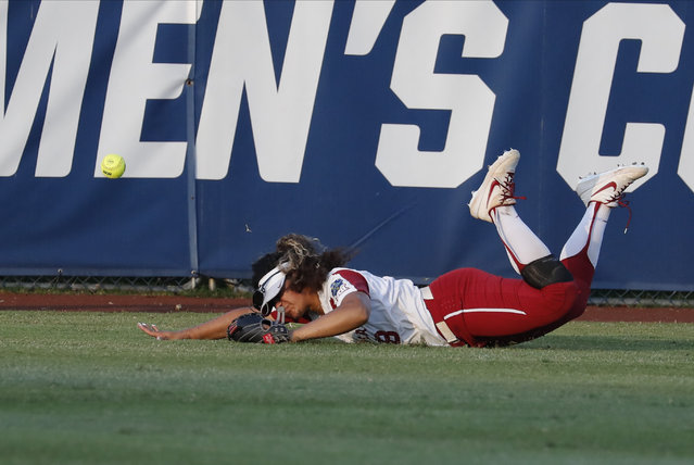 Oklahoma's Jocelyn Alo misses a UCLA fly ball to center field in the sixth inning of the first game of the best-of-three championship series in the NCAA softball Women's College World Series in Oklahoma City, Monday, June 3, 2019. (Photo by Alonzo Adams/AP Photo)