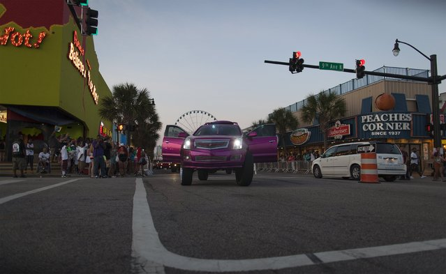 A customized SUV travels through the heart of the Myrtle Beach strand on Ocean Boulevard during the 2015 Atlantic Beach Memorial Day BikeFest in Myrtle Beach, South Carolina May 24, 2015. (Photo by Randall Hill/Reuters)