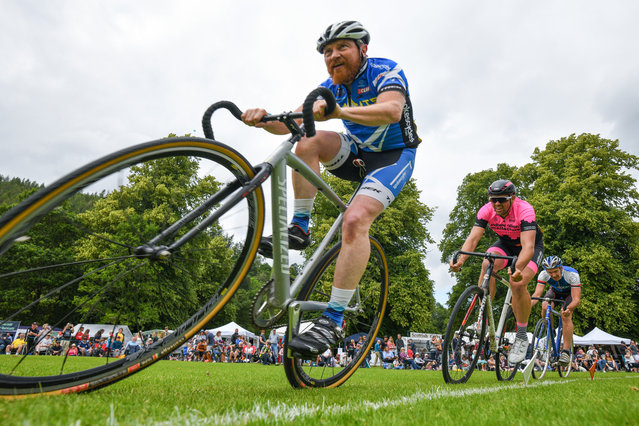 Cyclist compete at Inveraray Highland Games on July 16, 2019 in Inverarary, Scotland. The Games celebrate Scottish culture and heritage with field and track events, piping, highland dancing competitions and heavy events including the world championships for tossing the caber. (Photo by Jeff J. Mitchell/Getty Images)