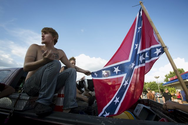 "Zachery Campbell sits in the back of his pickup truck before a ""Ride for Pride"" event to show support for the Confederate flag in Brandon, Hillsborough County, June 26, 2015. (Photo by Carlo Allegri/Reuters)"