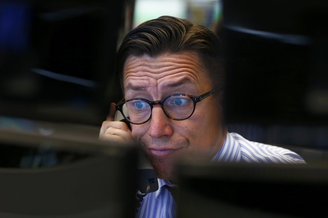 A trader speaks on the phone at his desk at the Frankfurt stock exchange, Germany, June 29, 2015.  European shares took a hammering in early deals on Monday, with Southern European banks especially badly hit, after Greece closed its banks and imposed capital controls as a result of its debt problems. (Photo by Ralph Orlowski/Reuters)