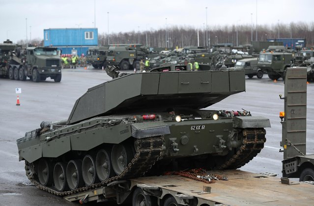 A British Army Challenger 2 tank of the 5th Battalion The Rifles drives backwards onto a truck trailer for transport after the tank and other heavy vehicles arrived by ship on March 22, 2017 at Paldiski, Estonia. (Photo by Sean Gallup/Getty Images)