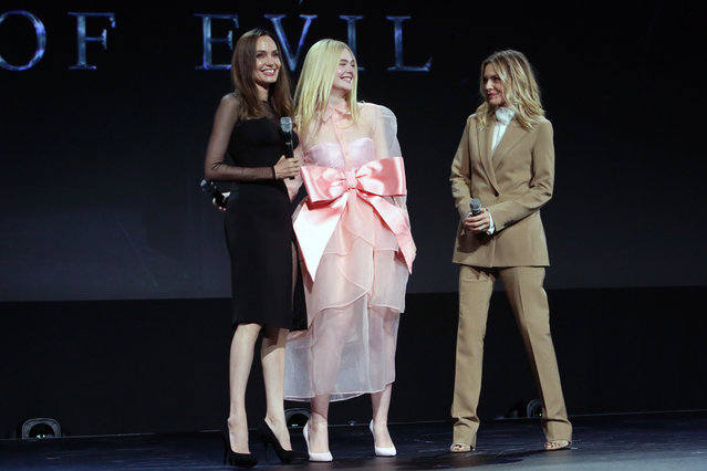 """(L-R) Angelina Jolie, Elle Fanning, and Michelle Pfeiffer of """"Maleficent: Mistress of Evil"""" took part today in the Walt Disney Studios presentation at Disney's D23 EXPO 2019 in Anaheim, Calif. """"Maleficent: Mistress of Evil"""" will be released in U.S. theaters on October 18, 2019. (Photo by Jesse Grant/Getty Images for Disney)"""