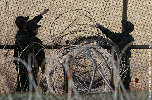 South Korean soldier check the barbed-wire fence at Imjinkak, near the Demilitarized zone (DMZ) separating South and North Korea