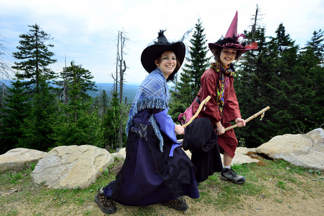 Silke (L) and Lara (R) pose dressed as witches near the mountain Broken on April 30, 2014 near Schierke, Germany. Both Silke and Lara are taking part in the Walpurgis Night celebration. Walpurgis, named after Saint Walpurga, is celebrated in countries in central and northern Europe and is traditionally marked with bonfires and dancing to usher in the spring season. In the Harz region Walpurgis is also associated with witches in a tradition going back centuries. (Photo by Thomas Lohnes/Getty Images)