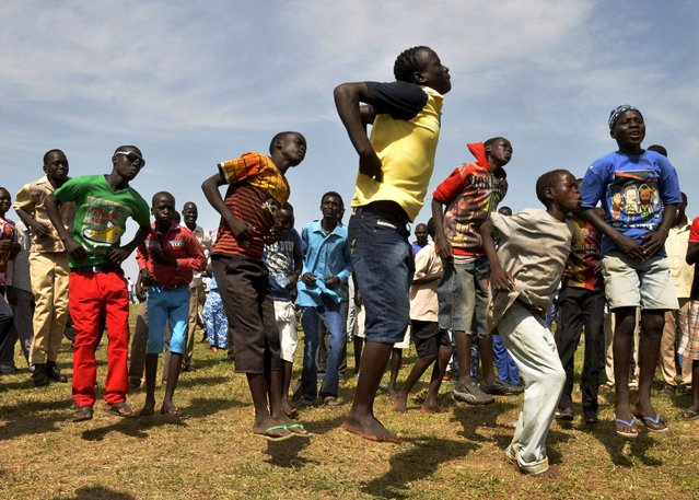South Sudanese people dance at John Garang's Mausoleum to celebrate the 4th Independence Day in the capital Juba July 9, 2015. (Photo by Jok Solomoun/Reuters)