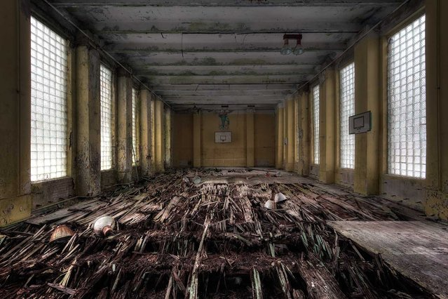 """A basketball court in a former military complex near Berlin. This place was used by the Nazis until the end of the Second World War. Movies like """"Mein Führer"""", """"Enemy at the Gates"""" and """"Inglorious Basterds"""" were also filmed here. (Photo by Vincent Jansen)"""