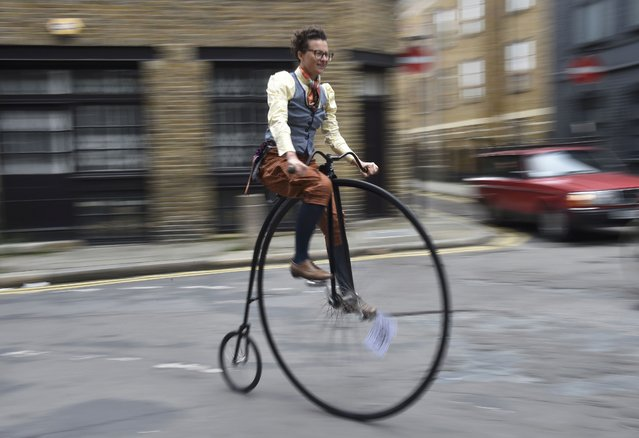 A participant sets off on a penny-farthing bicycle at the start of the The Tweed Run in central London, Britain, May 14, 2016. (Photo by Hannah McKay/Reuters)
