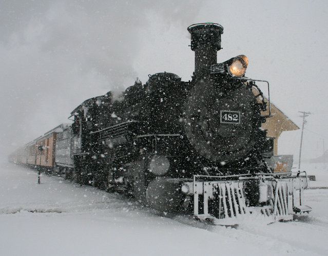 A Durango & Silverton Narrow Gauge Railroad passenger train arrives in Silverton, Colo., on Sunday, May 11, 2014, amid a severe snowstorm that dropped more than a foot on the San Juan Mountains of southwest Colorado. (Photo by Mark Esper/AP Photo/Silverton Standard)