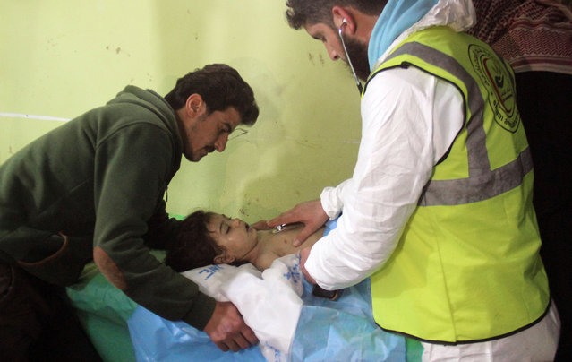 An unconscious Syrian child receives treatment at a hospital in Khan Sheikhun, a rebel-held town in the northwestern Syrian Idlib province, following a suspected toxic gas attack on April 4, 2017. A suspected chemical attack killed at least 58 civilians including several children in rebel-held northwestern Syria, a monitor said, with the opposition accusing the government and demanding a UN investigation. (Photo by Omar Haj Kadour/AFP Photo)
