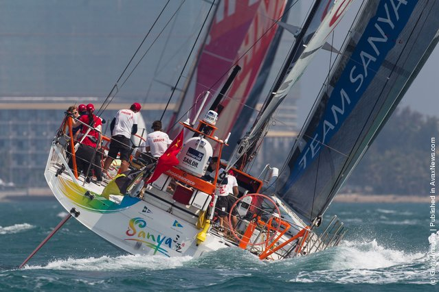 Team Sanya, skippered by Mike Sanderson from New Zealand sails behind CAMPER with Emirates Team New Zealand, skippered by Chris Nicholson from Australia during the start of leg 4 of the Volvo Ocean Race 2011-12