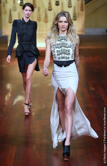 Model Jessica Hart (R) showcases designs by Ellery on the catwalk at the Myer A/W 2012 Collection Launch