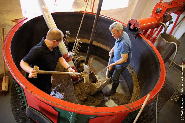 Workers clear out the Mash Tun at Edradour distillery on March 26, 2012 in Pitlochry, United Kingdom