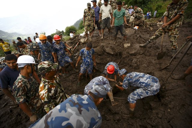 Rescue team members search for landslide victims at Lumle village in Kaski district July 30, 2015. (Photo by Navesh Chitrakar/Reuters)