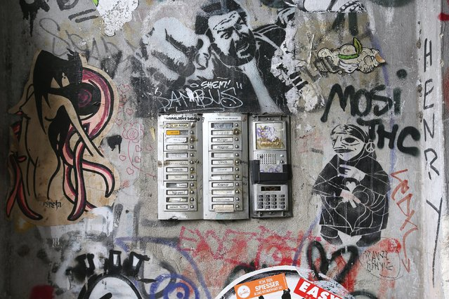 Street art and graffiti cover the entrance to an apartment building in Oranienstrasse in Kreuzberg district on June 26, 2014 in Berlin, Germany. Berlin, with its long tradition of counter-culture, has become a mecca for street art of all dimensions and messages. (Photo by Sean Gallup/Getty Images)