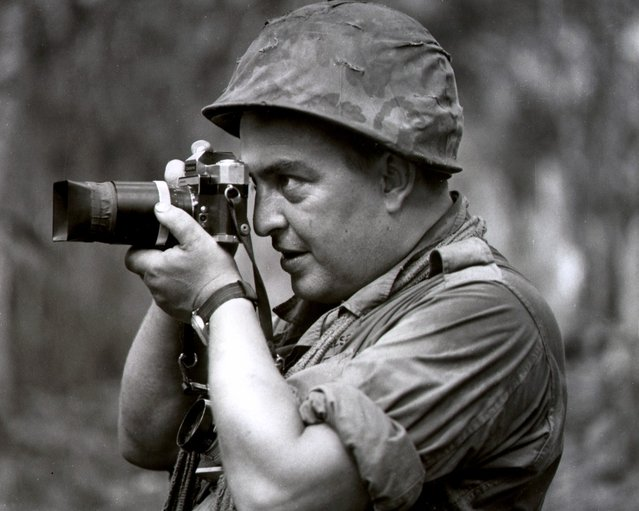 In this 1967 photo, Associated Press photographer Horst Faas works in Vietnam. Faas, a prize-winning combat photographer who carved out new standards for covering war with a camera and became one of the world's legendary photojournalists in nearly half a century with The Associated Press, died May 10, 2012. He was 79