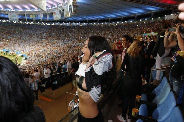 Rihanna celebrates by flashing the crowd on July 13, 2014 in Rio de Janeiro, Brazil. (Photo by  Twitter.com)