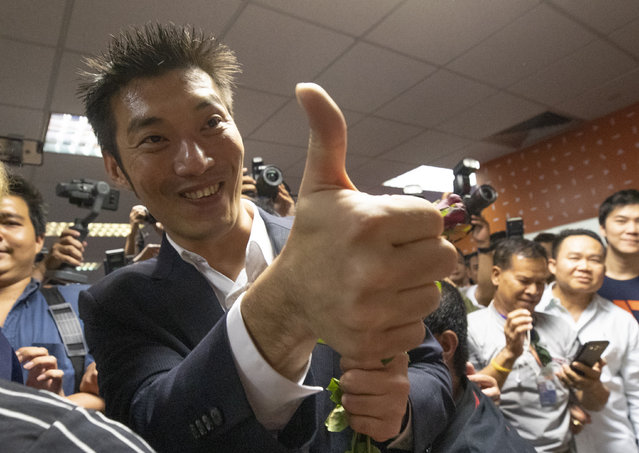 Thailand's Future Forward Party leader Thanathorn Juangroongruangkit gestures to supporters at the party's headquarters in Bangkok, Thailand, Tuesday, January 21, 2020. Thailand's Constitutional Court acquitted the country's third-biggest political party of seeking the overthrow of the country's constitutional monarchy. The court ruled Tuesday that the Future Forward Party showed no intention of committing the offense, and that the complaint had not been filed according to the correct legal procedure. (Photo by Sakchai Lalit/AP Photo)