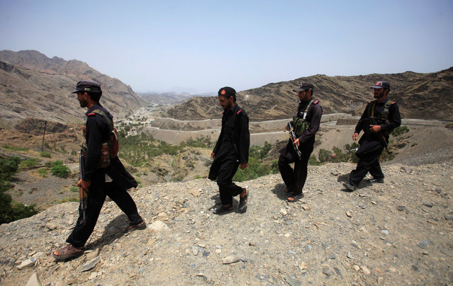 Members of Pakistan's Frontier Corps patrol the border region outside Torkham, Pakistan June 16, 2016. (Photo by Fayaz Aziz/Reuters)
