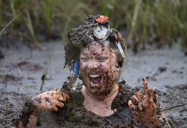 A female entrant takes a dip in the so called Bog Jacuzzi after takes part in the Irish Bog Snorkelling championship this afternoon at Peatlands Park on July 27, 2014 in Dungannon, Northern Ireland. The annual event sees male and female competitors swim the 60m length of the bog watched by scores of spectators and takes place on International Bog Day. (Photo by Charles McQuillan/Getty Images)