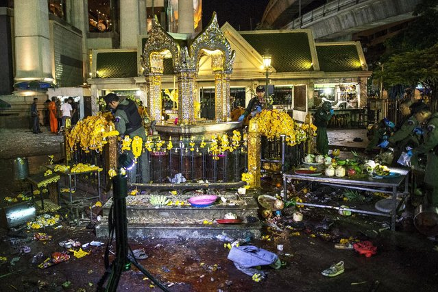 Experts investigate at the Erawan shrine, the site of a deadly blast in central Bangkok August 17, 2015. (Photo by Athit Perawongmetha/Reuters)