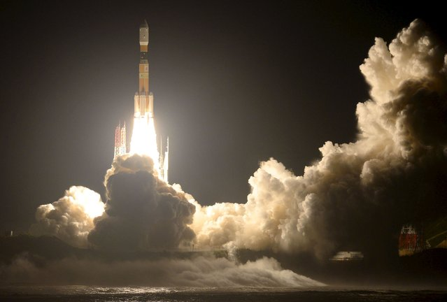 "A H-2B rocket carrying cargo craft for the International Space Station (ISS) called ""Kounotori No.5"" blasts off from the launching pad at Tanegashima Space Center on the Japanese southwestern island of Tanegashima, Kagoshima prefecture, southwestern Japan, in this photo taken by Kyodo August 19, 2015. ""Kounotori"" which is Japanese for White stork lifted off with supplies for the International Space Station on Wednesday. The unmanned cargo craft is bringing food, hygiene items and spare parts to the ISS. (Photo by Reuters/Kyodo News)"