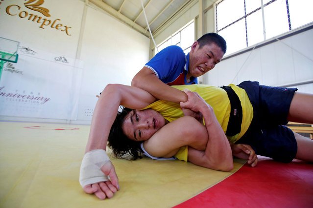 Mongolia's Olympic wrestler Battsetseg Soronzonbold (front) fights with her training partner during a daily training session at the Mongolia Women's National Wrestling Team training centre in Bayanzurkh district of Ulaanbaatar, Mongolia, July 1, 2016. Battsetseg Soronzonbold became a national hero in her native Mongolia after winning wrestling bronze at the London Olympics and is determined to turn the medal into gold in Rio next month. (Photo by Jason Lee/Reuters)