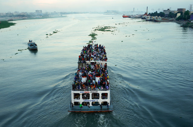 A ferry with passengers traveling home to celebrate Eid al-Fitr festival leaves Dhaka, Bangladesh June 23, 2017. (Photo by Mohammad Ponir Hossain/Reuters)