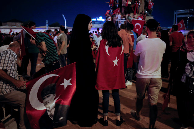 Supporters of Turkish President Tayyip Erdogan gather in Taksim Square during a pro-government demonstration in Istanbul, Turkey, July 16, 2016. (Photo by Alkis Konstantinidis/Reuters)