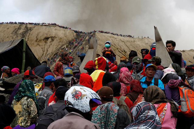 Mount Bromo spews ash as Hindu villagers and visitors gather ahead of Kasada ceremony, when villagers and worshippers throw offerings such as livestock and other crops into the volcanic crater of Mount Bromo, in Probolinggo, Indonesia, July 20, 2016. (Photo by Reuters/Beawiharta)