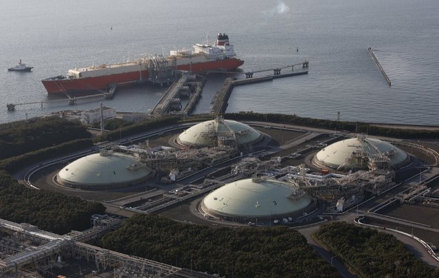 Liquefied natural gas (LNG) storage tanks and a membrane-type tanker are seen at Tokyo Electric Power Co.'s Futtsu Thermal Power Station in Futtsu, east of Tokyo, in this February 20, 2013 file photo. Asian liquefied natural gas (LNG) prices could fall a further 25 percent in coming months as new supply, falling demand and weaker oil prices put it on par with iron ore and coal as the worst performing commodity of recent years. (Photo by Issei Kato/Reuters)