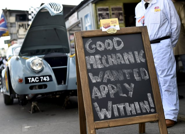 A sign is seen outside a garage as visitors and car enthusiasts attend the Goodwood Revival historic motor racing festival in Goodwood, near Chichester in south England, Britain, September 11, 2015. (Photo by Toby Melville/Reuters)