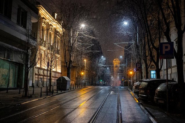 Snow falls at empty Resavska street during a curfew imposed to prevent the spread of coronavirus disease (COVID-19) in Belgrade, Serbia, March 23, 2020. (Photo by Marko Djurica/Reuters)