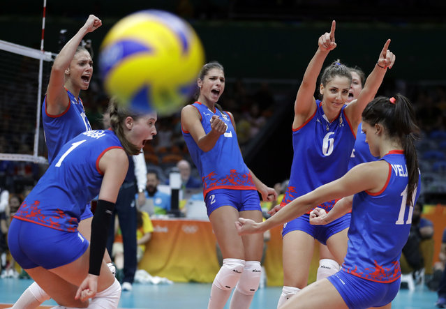 Serbia's team celebrates during their women's preliminary volleyball match against the Netherlands at the Summer Olympics in Rio de Janeiro, Brazil, Sunday, August 14, 2016. (Photo by Jeff Roberson/AP Photo)