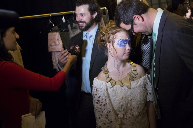 Designer Hendrik Vermeulen (L-R), Madeline Stuart, an Australian model with Down Syndrome, and JD Meyer-Vermeulen are interviewed backstage after presenting the Hendrik Vermeulen label during the FTL Moda presentation of the Spring/Summer 2016 collection during New York Fashion Week in Vanderbilt Hall at Grand Central Station, New York, September 13, 2015. (Photo by Andrew Kelly/Reuters)